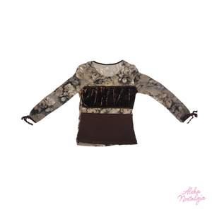 Y2k tröja men olika material och mönster och knyt längst ner på ärmarna <3 superbra skick