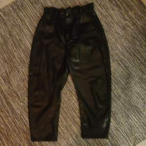 High waisted faux leather pants, size 44.