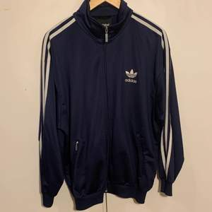 A vintage adidas originals jacket from mid to late 1900s in good condition.