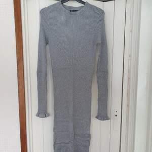 Långklänning med stretchigt material