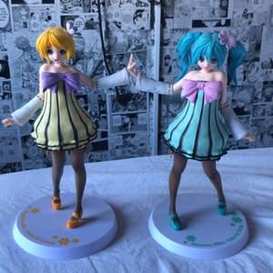 Två vocaloid figurer, kagamine rin och hatsune miku.