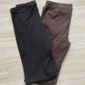 Bruna och svarta leggings i strl 34. Mycket gott skick!
