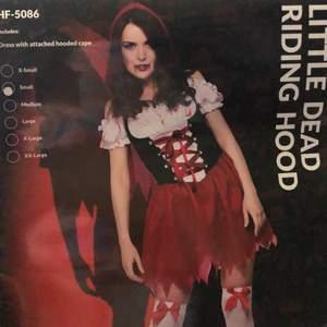 """Utklädnad """"Little Dead Riding Hood"""" från Wicked costumes. I storlek Small. Endast använd en gång. Bra passform enligt mig."""