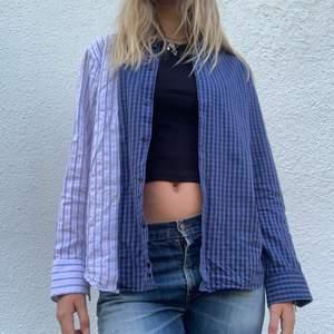 En skitball skjorta som jag själv sytt av två olika skjortor ( köpta second-hand). Den går att knäppa precis som en vanlig skjorta, och är ganska over-sized i storleken. Jättecool att ha som en overshirt eller liknande.