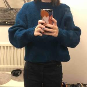 Dieselblå stickad tröja från H&M