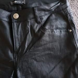 Black coated super skinny trousers - worn once.