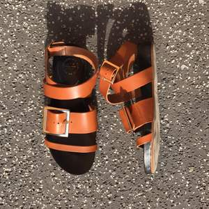 ATP sandals in brown leather with shaped sole and build up layer what make the feet feel comfy while walking. They are worn once o  Selling these because I bought them too small, thought they were my size, I'm a size 38, but they turned out to be too small.
