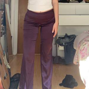 groovy shiny purple pants. these have unfortunately gotten too small for me but they are great party pants ☺️