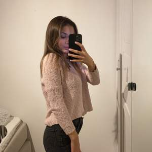 Baby rosa stickad tröja från Åhléns