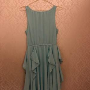 A blue long summer dress for children, it fits big because it's very stretchy. Has only been used once, I bought it at H&M but they don't sale it anymore. It's in great condition no flaws or anything, it's very comfortable and cute.