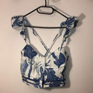 """Never used-still with a tag cute top with crossed back from H&M. Size """"small"""" 42."""