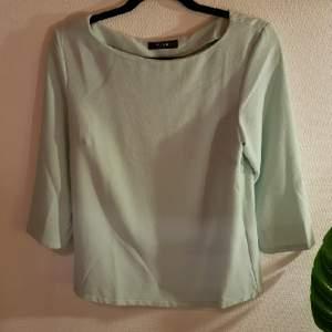 tröja från vila i mint grön färg