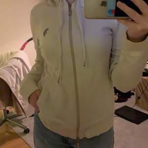 beige zip hoodie från us polo. köparen står för frakt!
