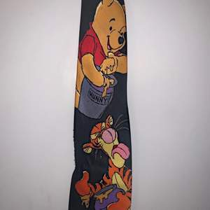 Cute winne the pooh tie, a little textured at the bottom barley noticable.