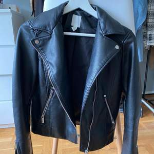 Black faux leather jacket from H&M. Brand new, selling it because it is a little small on me. Size 34