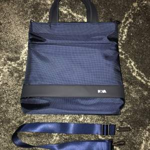 Waterproof navy tote from the brand Nava. Never worn, in perfect condition.