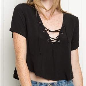 Bought this from Mercari in the US. Preloved cropped shirt blouse with lace-up front v neck. Shirttail hem. Tag size OSFA
