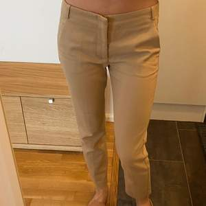 Beige mid waist chinos from Zara, selling because they are too big for me.