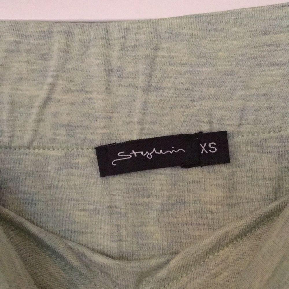 Snygg tubtopsklänning från Stylein, aldrig använd . Mintgrön färg :) . Klänningar.