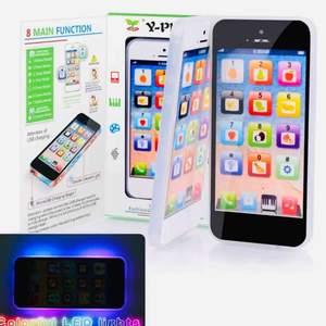 Ny PLOMBERAD  LED IPHONE LEKSAK  LEK & LÄR MOBILTELEFON. barn /1,4 år>. Vill du ha din egna smartphone mobil ifred ? Passar denna utmärkt. *Bjuder på portot. *Ny inplastad. * Snabb leveranstid :1-3 vardagar