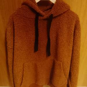 Fluffy hoodie, used it a lot but there's no holes or tears.100% polyester
