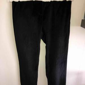 Black velvet trousers. New. Perfect condition. No need iron for smart wardrobe lovers.