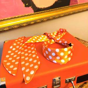 Cute orange hair band with white dots Very 50's