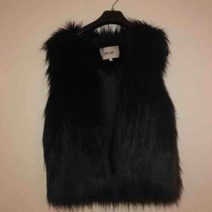 Fake fur vest. Perfect condition!
