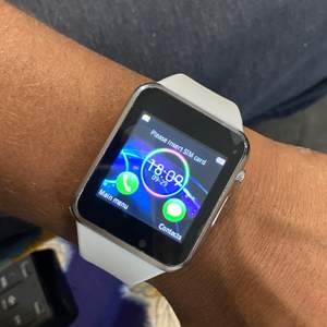 Brand New! Generation 6 Smartwatch comes with Charger and User Manual. Does require SIM card, this Watch has a lot of great features! Access your Facebook, Twitter, Notifications, even has a camera where you can take a picture directly on your watch!