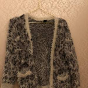 Very cozy cardigan sweater for kids. I bought it from H&M, but they don't sale it anymore, it's from the kids section but it's very stretchy, very cozy for winter and atume. Any questions?