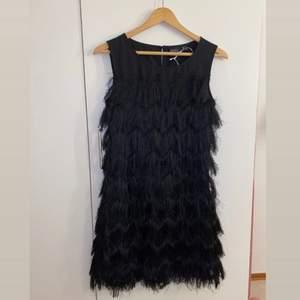 En klänning jag köpte o aldrig använde den för att den blev för liten när jag skulle använda den. Den är väldigt mjuk.    Inkluderad frakt