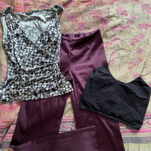 one vintage patterned tanktop (S/M), one spaghetti strap tank top (S), one pair of silky shiny flared trousers (S). most items have their own ads up on my page (so you can see photos of the items on and purchase them separately).