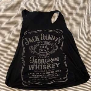 Jack Daniels linne, passar xs och s. Såå snyggt!