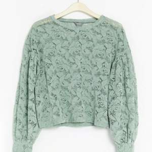 Green Lindex long-sleeve shirt with flower pattern. Worn only once