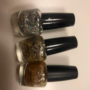 Three unopened nail glitter polish. One silver, golden and bronze golden. All are new and not used.
