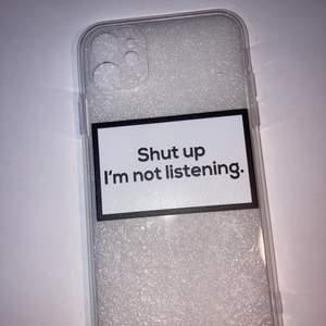 """iPhone skal med text där det står """"shut i'm not listening. Storleken på skalet är iPhone 11. Frakten kostar 12kr"""