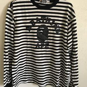 Unisex Bape / A Bathing Ape Striped Long Sleeve T-Shirt  Size large, fits like a regular men's medium. Great condition, no flaws or damage.  DM if you need exact size measurements.   Buyer pays for all shipping costs. All items sent with tracking number.   No swaps, no trades, no offers.