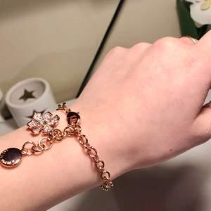 Armband brons/rosé guld färg, blomma 🌺