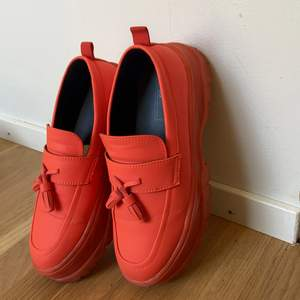 Bright orange loafers perfect for the summer