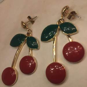 Never used red, green and gold cherry earrings. Not at all heavy or damaged