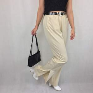 Amazing Gerry Weber trousers in thin material and beige, size US 14. 90% polyester and 10% elastane. Slits at the bottom on each leg. No return nor refund. Free shipping.  Waist 45cm Length (from the waist and down) 108cm