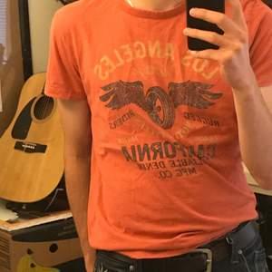 Orange t-shirt från jack and Jones i storlek Medium