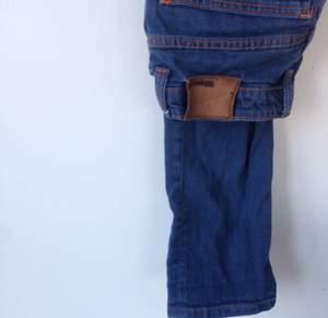 Snygga tighta Whyred-jeans med orange söm. Säljer pga för små