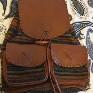 Almost new backpack with a vintage design, high quality materials. Perfect condition.