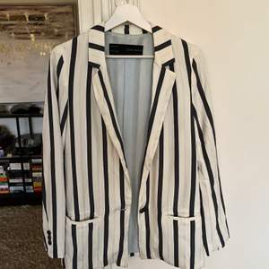 White-blue striped blazer from Zara.