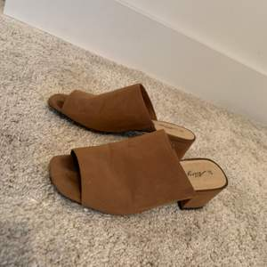 Nude/beige/tan colourd mules. Comfortable to walk in. Condition is good. Size 37