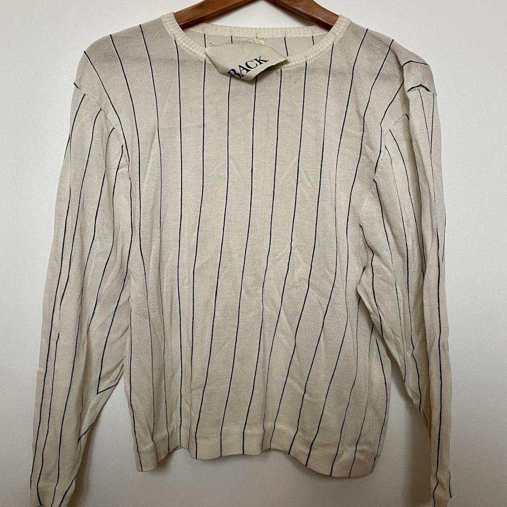Stickad tröja i bomull från Ann Sofie Back, storlek 34. Använd några gånger men toppen skick! Pris ny ca 1000 kr.. Toppar.