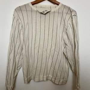 Stickad tröja i bomull från Ann Sofie Back, storlek 34. Använd några gånger men toppen skick! Pris ny ca 1000 kr.