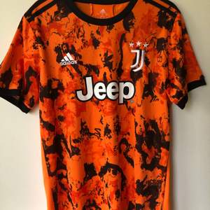 Adidas Juventus Orange 20/21 3rd Jersey Size medium, fits like a regular men's size medium.  Excellent condition, no flaws or damage.  DM if you need exact size measurements.   Buyer pays for all shipping costs. All items sent with tracking number.   No swaps, no trades, no offers.