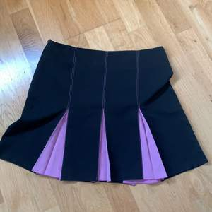 black and pink undertone pleated skirt. A bit long but if you are taller it would work as a mini skirt